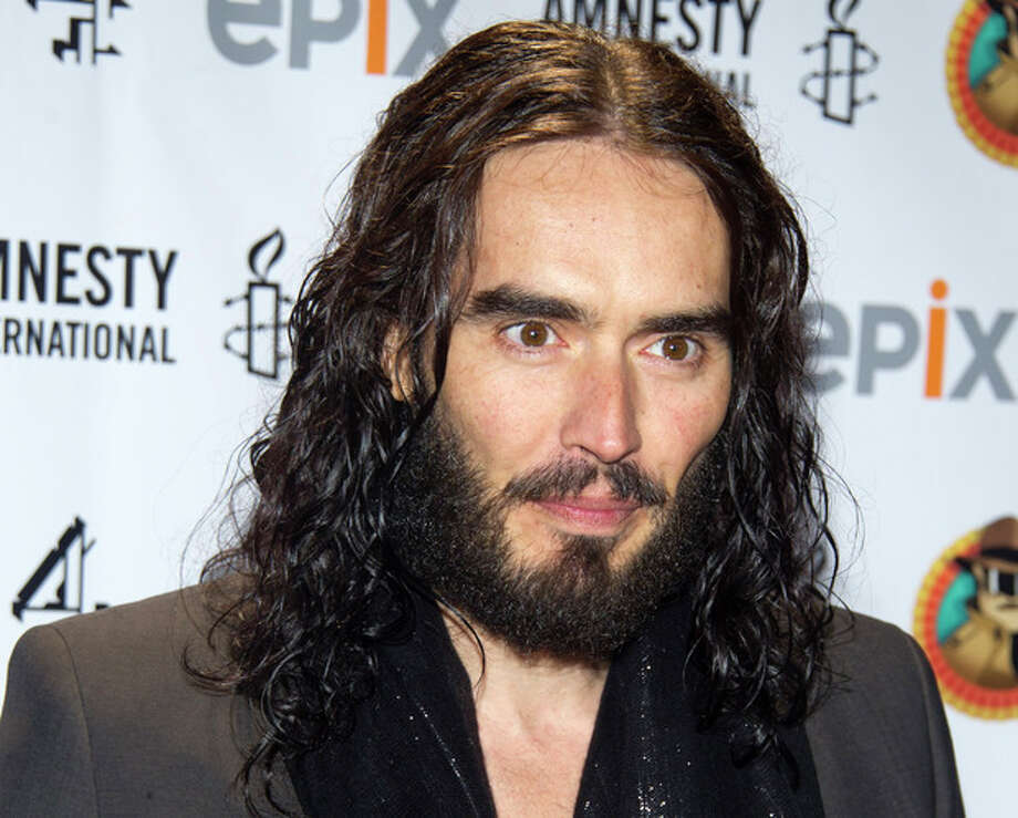 "FILE - In this March 4, 2012 file photo, Russell Brand arrives to Amnesty International's ""Secret Policeman's Ball"" in New York. The MTV network says the 36-year-old comedian will host the 2012 MTV Movie Awards June 3, 2012. (AP Photo/Charles Sykes, file) / AP2012"