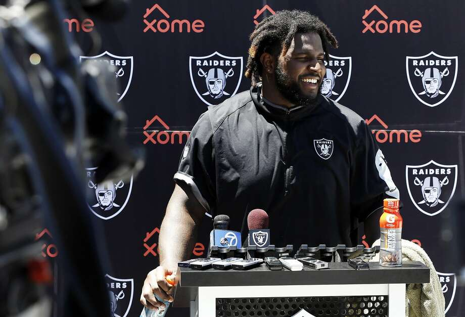 Mario Edwards Jr. — and the Raiders coaching staff — had reason to smile after his return to the field as the team's minicamp. Photo: Connor Radnovich, The Chronicle