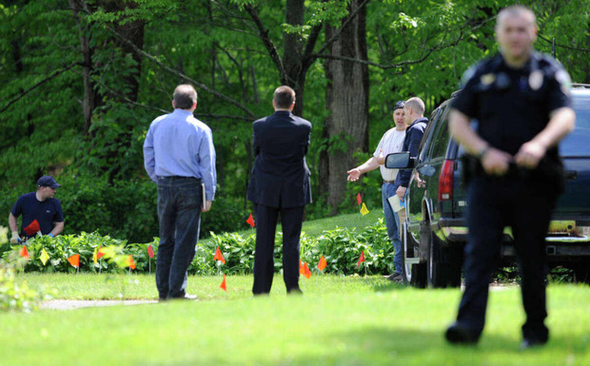 Law enforcement agents search the back yard of the home of reputed Connecticut mobster Robert Gentile in Manchester, Conn., Thursday, May 10, 2012. Gentile's lawyer A. Ryan McGuigan says the FBI warrant allows the use of ground-penetrating radar and believes they are looking for paintings stolen from Boston's Isabella Stewart Gardener Museum worth half a billion dollars. (AP Photo/Jessica Hill)