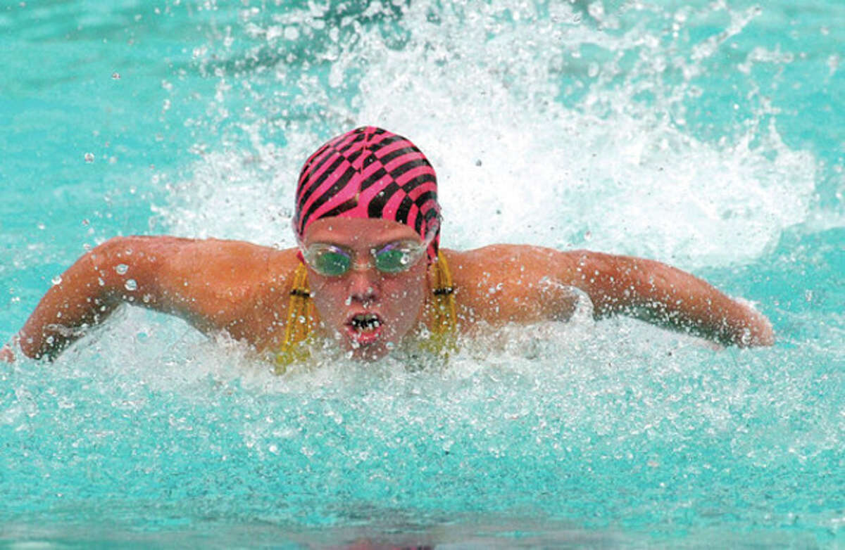 Quinn Scannell competes for Stamford Yacht Club in the 25 meter butterfly at the Fairfield County Swimming League Championships at the Roxbury Swim Club in Stamford Saturday.