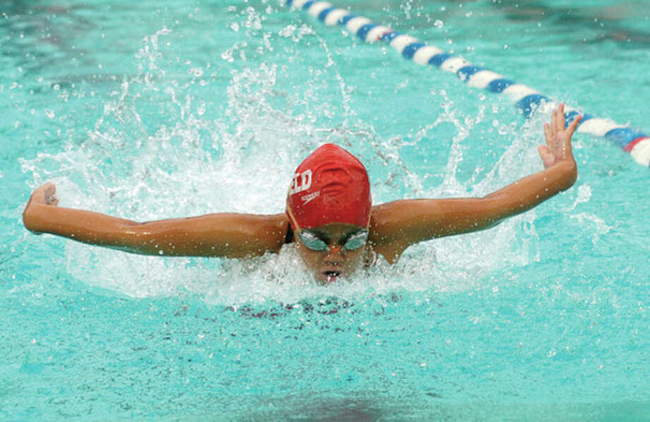 Jenna Handali competes in the 25 Meter Butterfly at the Fairfield County Swimming League Championships at the Roxbury Swim Club in Stamford Saturday. / (C)2011, The Hour Newspapers, all rights reserved