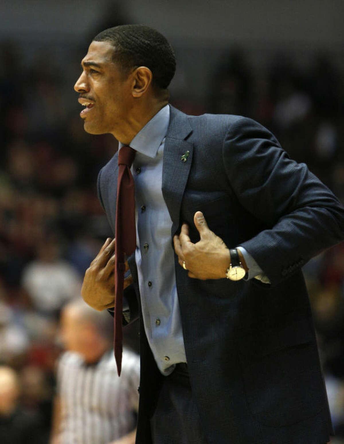 Connecticut head coach Kevin Ollie reacts during the first half of an NCAA basketball game against Cincinnati, Saturday, March 2, 2013, in Cincinnati. (AP Photo/David Kohl)
