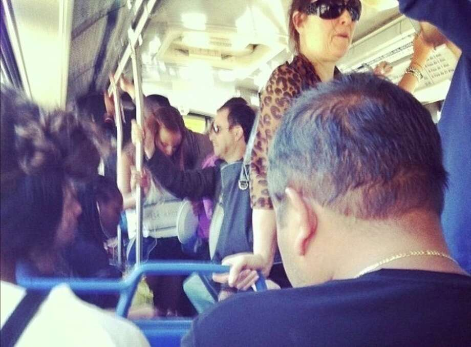 Contributed photo A crowded bus with train passengers riding between East and South Norwalk train stations Sunday.
