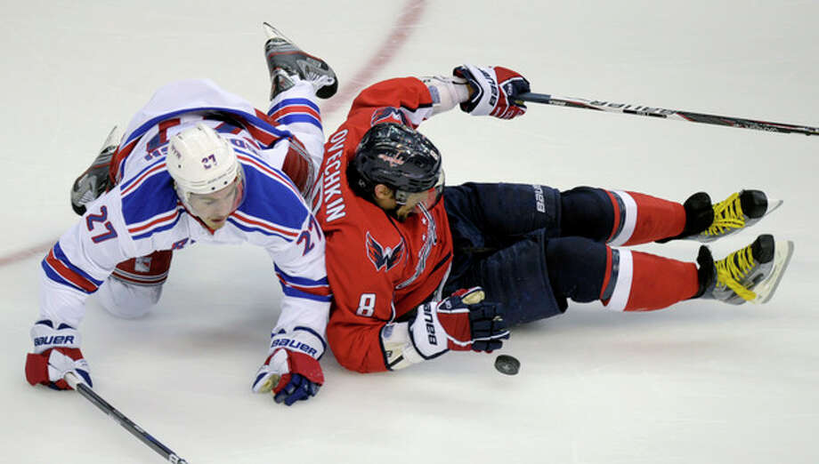 Washington Capitals left wing Alex Ovechkin (8) keeps control of the puck from New York Rangers defenseman Ryan McDonagh (27) in the third period of Game 6 of a second-round NHL hockey Stanley Cup playoff series in Washington, Wednesday, May 9, 2012. (AP Photo/Susan Walsh) / AP