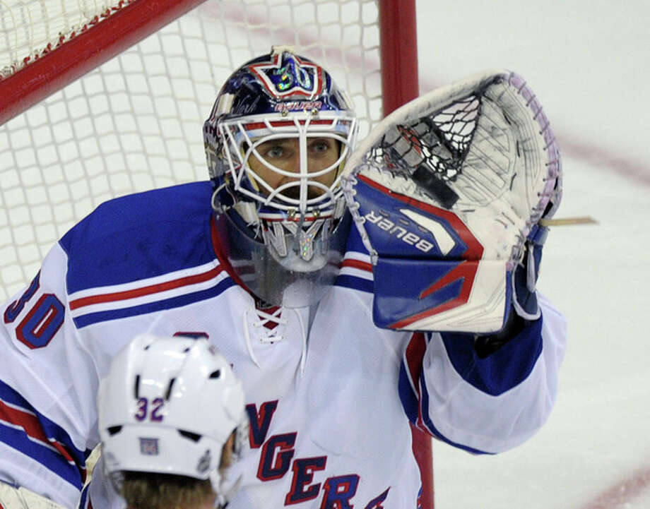 New York Rangers goalie Henrik Lundqvist (30) catches a shot by the Washington Capitals in the third period of Game 6 of a second-round NHL hockey Stanley Cup playoff series in Washington, Wednesday, May 9, 2012. The Capitals defeated the Rangers 2-1. (AP Photo/Susan Walsh) / AP