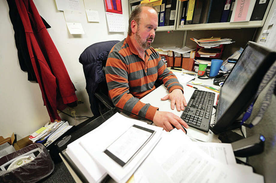 David Wasserman went through the P2E program at The Workplace to find emploment as a jr accountant at Kenndey Community Services after being long-term unemployed.Hour photo / Erik Trautmann / ©2012 The Hour Newspapers