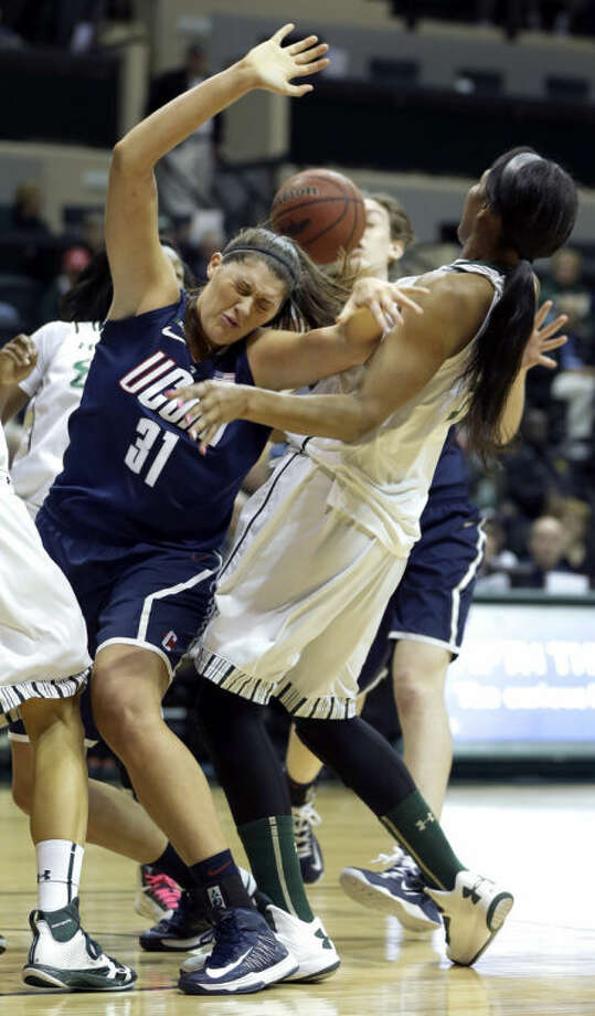 Connecticut center Stefanie Dolson (31) gets fouled by South Florida center Akila McDonald (32) during the first half of an NCAA college basketball game Saturday, March 2, 2013, in Tampa, Fla. (AP Photo/Chris O'Meara)