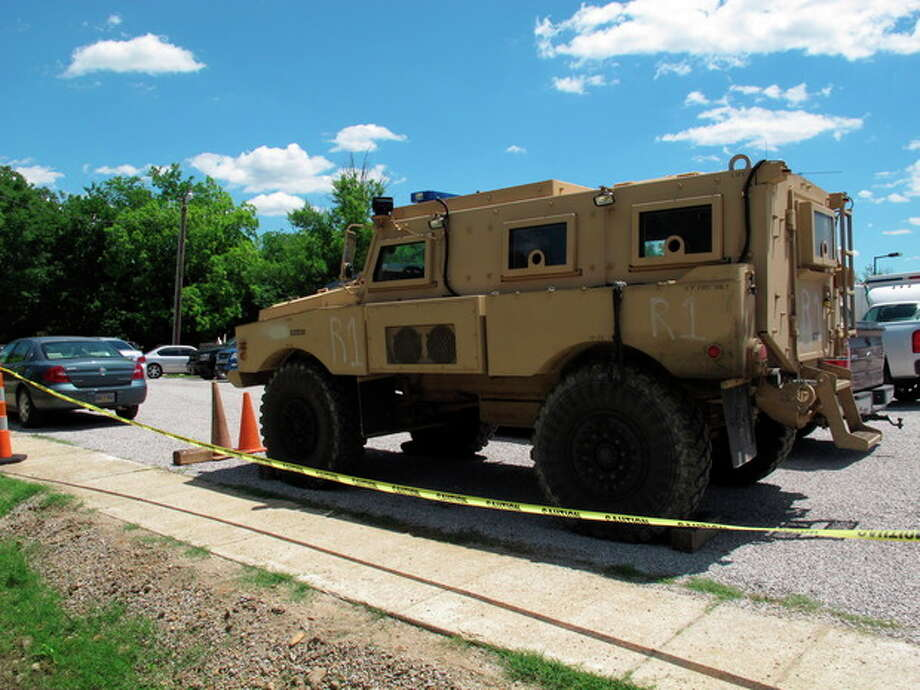 An armored vehicle sits in the parking lot of a command center set up to coordinate the search for two Tennessee girls and the man accused of abducting them and killing their mother and sister on Thursday May 10, 2012, in Guntown, Miss. The hunt for Adam Mayes and the two young sisters he is accused of kidnapping has encompassed parts of at least three counties in northern Mississippi. (AP Photo/Adrian Sainz) / AP