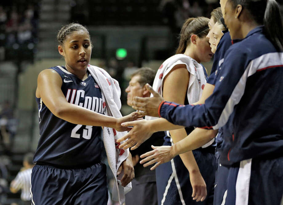 Connecticut forward Kaleena Mosqueda-Lewis (23) shakes hands with teammates after being taken out of the game during the second half of an NCAA women's college basketball game against South Florida Saturday, March 2, 2013, in Tampa, Fla. Mosqueda-Lewis scored 32 in UConn's 85-51 win. (AP Photo/Chris O'Meara) / AP