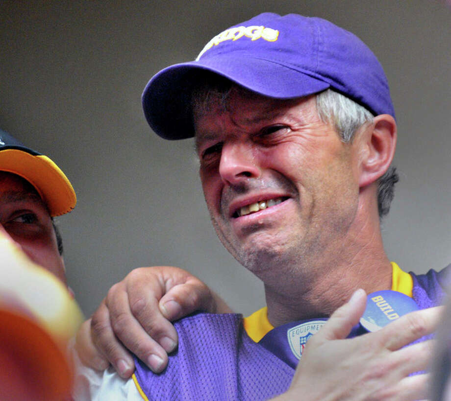Minnesota Vikings fan Larry Spooner of Plymouth, Minn. weeps as the Minnesota Senate votes to approve a new Vikings stadium,Thursday afternoon, May 10, 2012 at the State Capitol in St. Paul, Minn. The Vikings are on the brink of getting a new stadium after the state Senate approved a plan that relies heavily on public financing. Gov. Mark Dayton has said he'll sign the measure, which makes Thursday's Senate approval the final hurdle for the nearly $1 billion stadium. The House passed it overnight. (AP Photo/The St. Paul Pioneer Press, Chris Polydoroff) MINNEAPOLIS STAR TRIBUNE OUT, MAGS OUT Chris Polydoroff) / St. Paul Pioneer Press