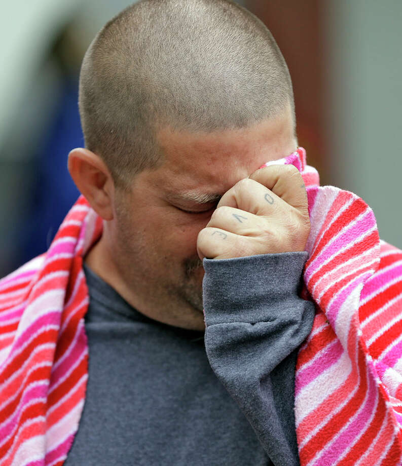 Jeremy Bush, brother of Jeff Bush, breaks down as he speaks to the media about attempting to rescue Jeff as he disappeared in a sinkhole Friday, March 1, 2013, in Seffner, Fla. Jeff Bush screamed for help and disappeared as a large sinkhole opened under the bedroom of the house, his brother said Friday. Jeremy Bush told rescue crews he heard a loud crash near midnight Thursday, then heard his brother screaming. There's been no contact with Jeff Bush since then, and neighbors on both sides of the home have been evacuated. (AP Photo/Chris O'Meara) / AP