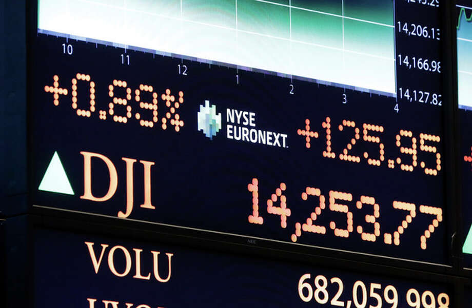 A board on the floor of the New York Stock Exchange shows the closing number for the Dow Jones industrial average, Tuesday, March 5, 2013. The Dow closed at an all-time high Tuesday, beating the previous record it set in October 2007, before the financial crisis and Great Recession. (AP Photo/Richard Drew) / AP