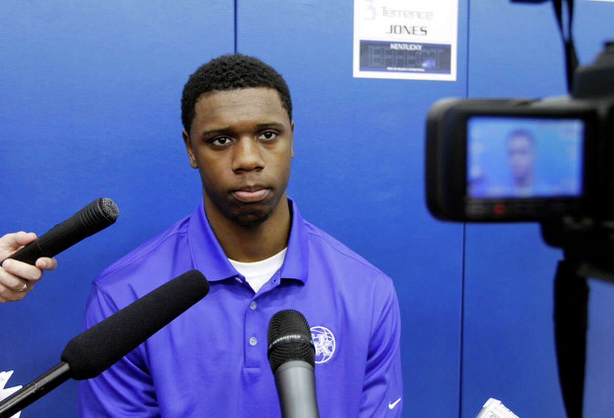 FILE - In this Oct. 13, 2011 file photo, Kentucky's Terrence Jones listens to a question from a member of the media during NCAA college basketball media day at the Joe Kraft Center in Lexington, Ky. Jones was selected to The Associated Press' preseason All-American team this season. (AP Photo/ James Crisp)