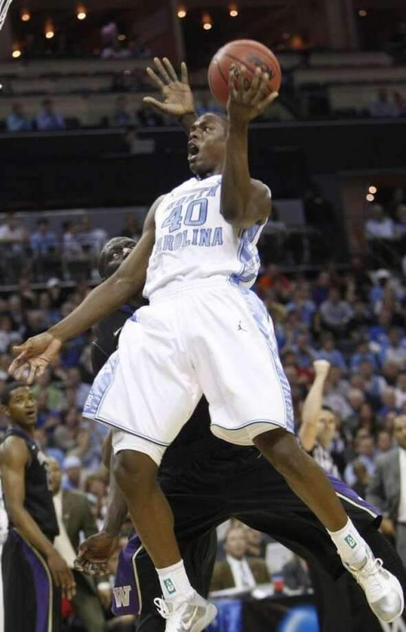 FILE - In this March 20, 2011 file photo, North Carolina forward Harrison Barnes (40) heads to the basket as Washington center Aziz N'Diaye defends from behind in the first half of an East Regional NCAA tournament third-round college basketball game, in Charlotte, N.C. Barnes was selected to The Associated Press' preseason All-American team this season. (AP Photo/Chuck Burton, File)
