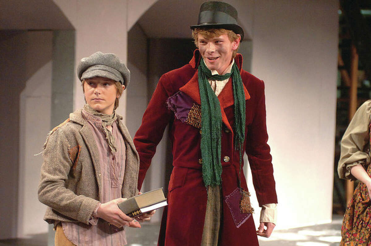 Hour Photo/ Alex von Kleydorff. Grant Hussey as Oliver is welcomed to Fagin's gang by The Artful Dodger played by Jack Furnival in Oliver