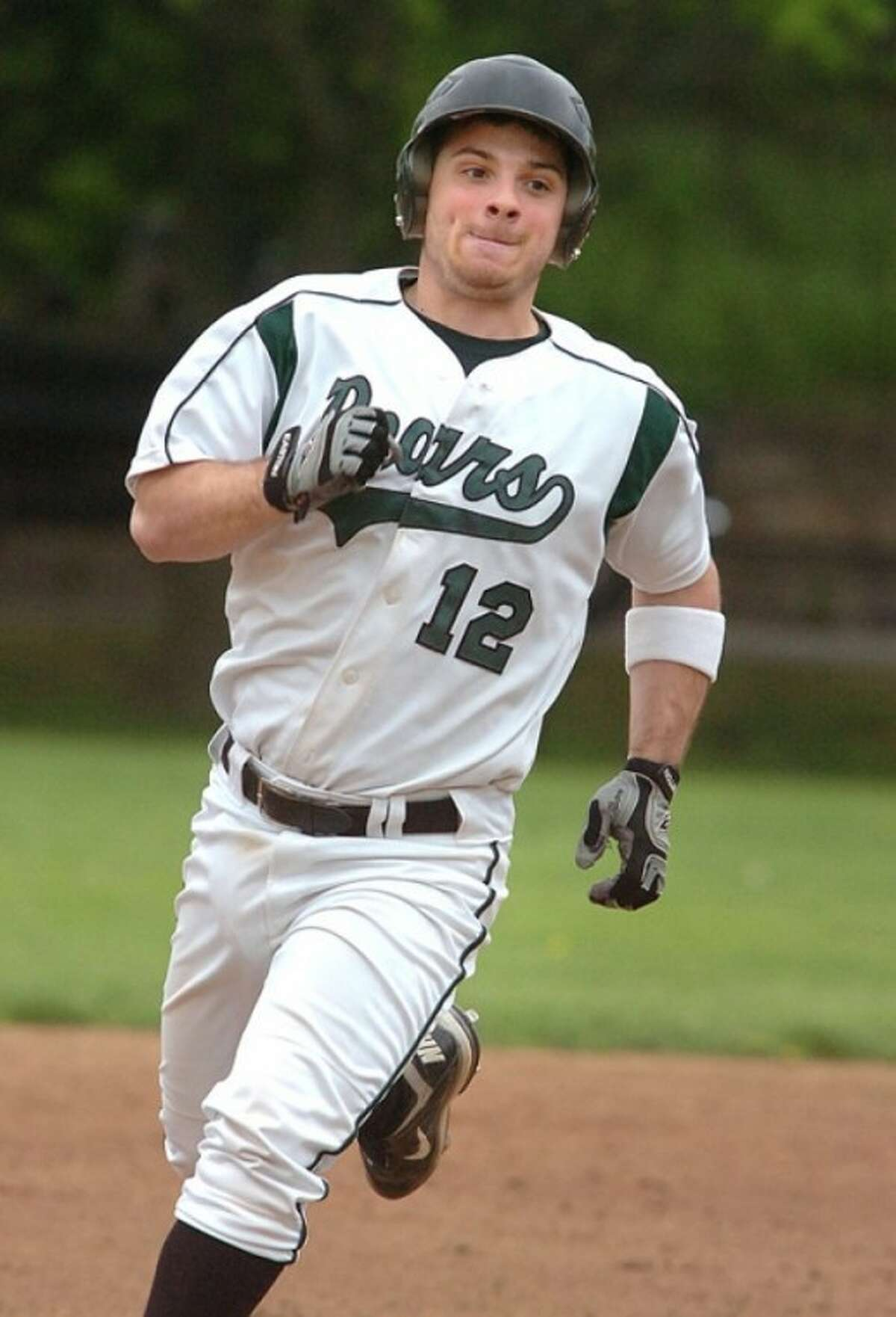 Photo/Alex von Kleydorff. Norwalks #12 heads for third base after hitting a triple vs Stamford