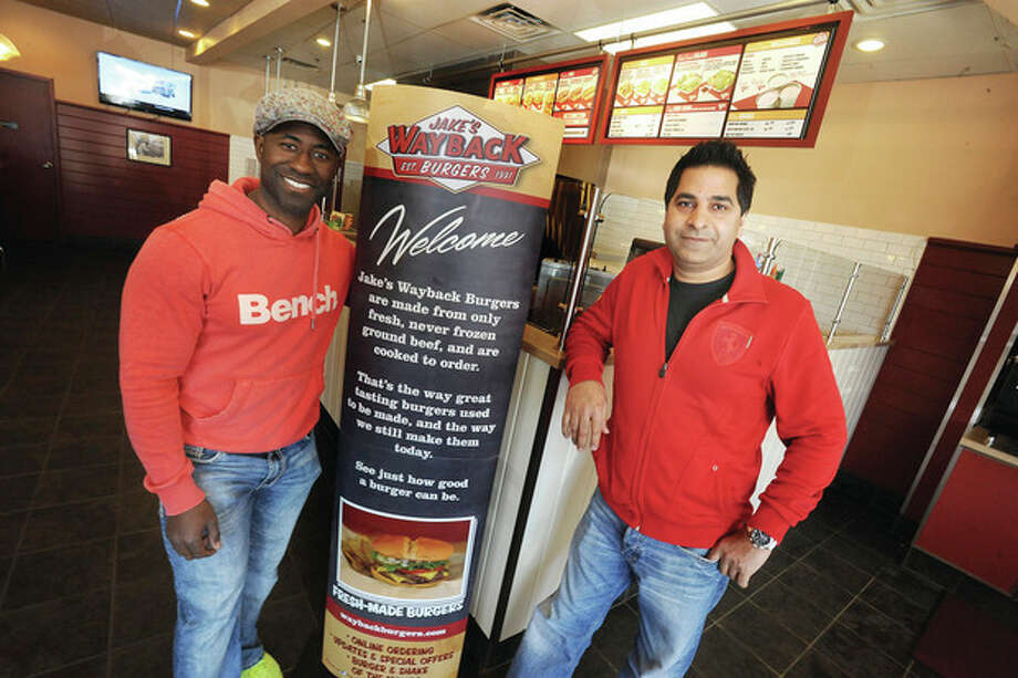 Hour photo / Matthew VinciOwners of the new Jake's Wayback Burgers on Main Avenue in Norwalk, Richard Anderson and Shahzad Mir.