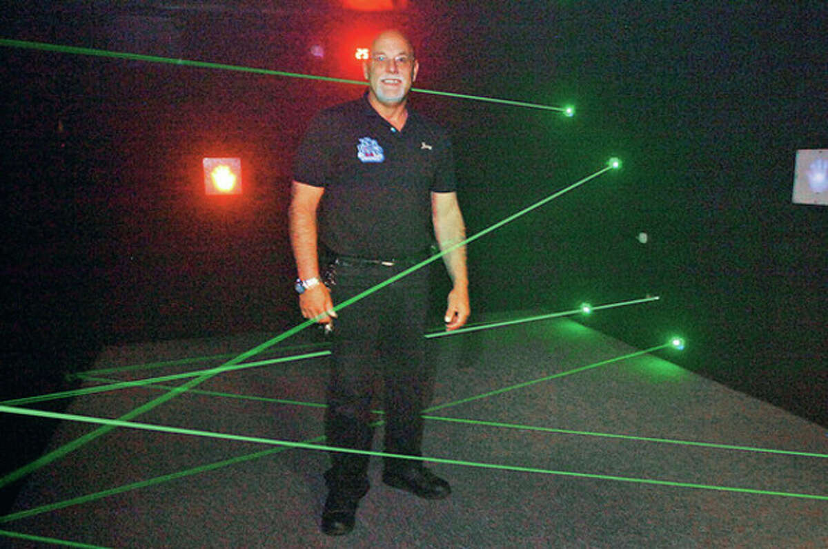 Hour photo / Erik Trautmann Owner of My Three Sons, Jerry Petrini, in the new attraction, The Vault: Laser Maze, after a recent expansion.