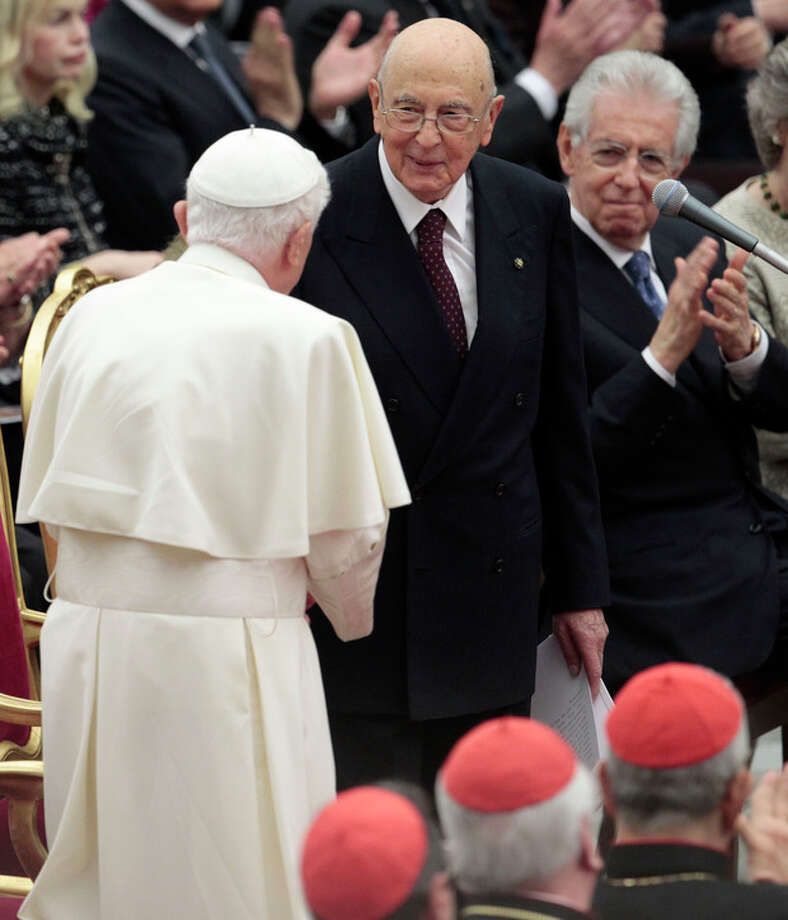 Pope Benedict XVI greets Italian President Giorgio Napolitano as they wait for the start a concert offered by Italian President to celebrate his Pontificate at the Vatican, Friday, May 11, 2012. (AP Photo/Gregorio Borgia) / AP