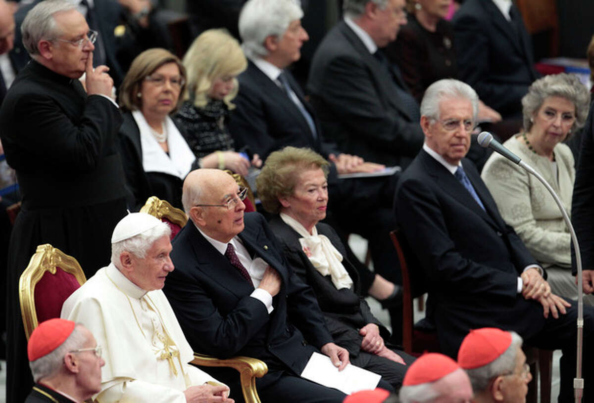 Pope Benedict XVI flanked by Italian President Giorgio Napolitano wait for the start a concert offered by Italian President to celebrate his Pontificate at the Vatican, Friday, May 11, 2012. (AP Photo/Gregorio Borgia)