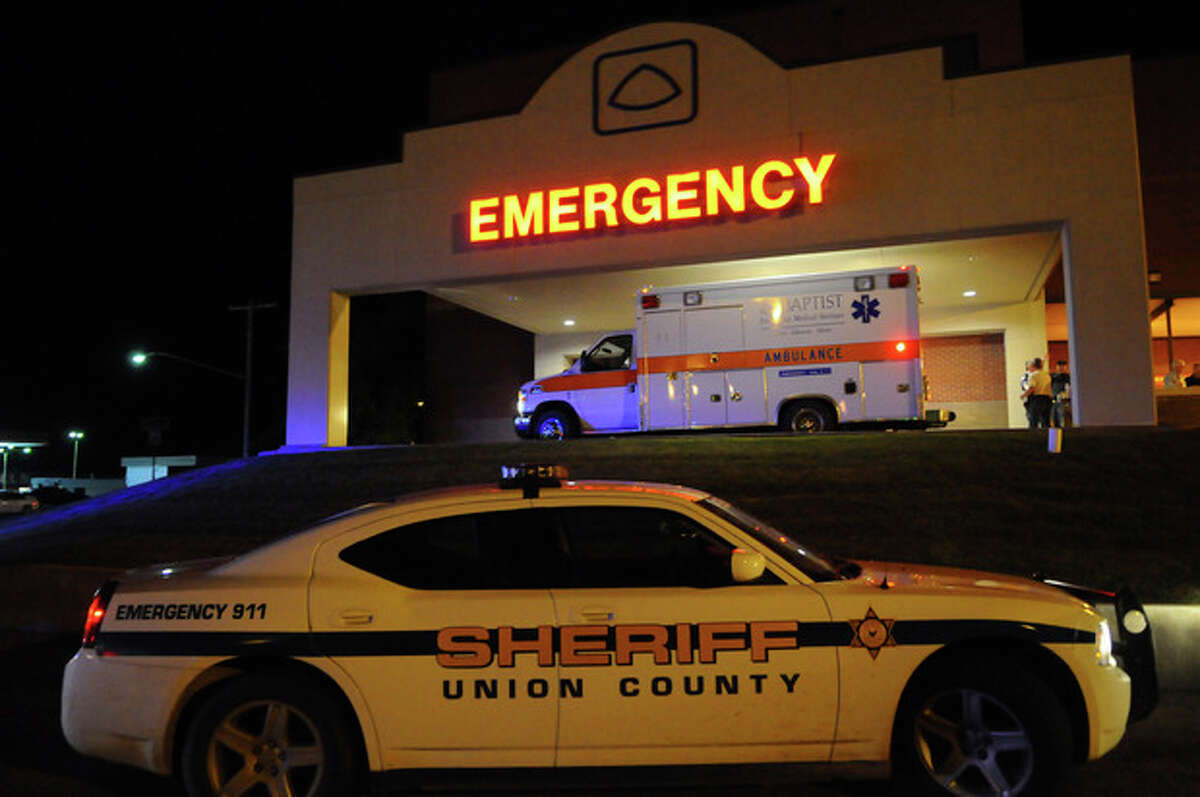 Various police agencies gather at Baptist Memorial Hospital-Union County in New Albany Mississippi after two missing sisters, Alexandria and Kyliyah Bain were rescued from their alleged kidnapper Adam Mayes Thursday May 10, 2012. (AP Photo/Alex Gilbert)