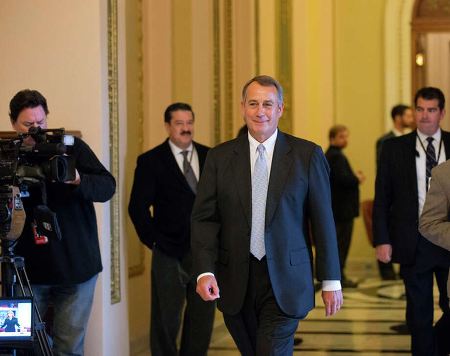 Speaker of the House John Boehner, R-Ohio, leaves the chamber after Republicans passed legislation through the House to ease the impact of $85 billion in short-term cuts and prevent a government shutdown later this month, on Capitol Hill in Washington, Wednesday, March 6, 2013. (AP Photo/J. Scott Applewhite) / AP