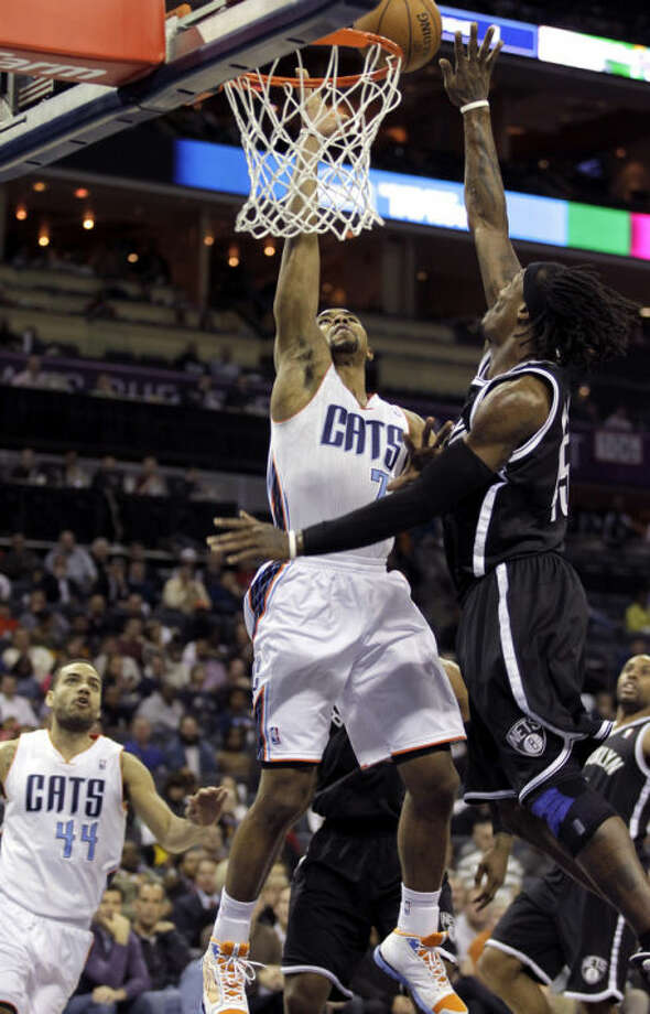 Charlotte Bobcats' Ramon Sessions (7) has his shot blocked by Brooklyn Nets' Gerald Wallace (45) during the first half of an NBA basketball game in Charlotte, N.C., Wednesday, March 6, 2013. (AP Photo/Bob Leverone)