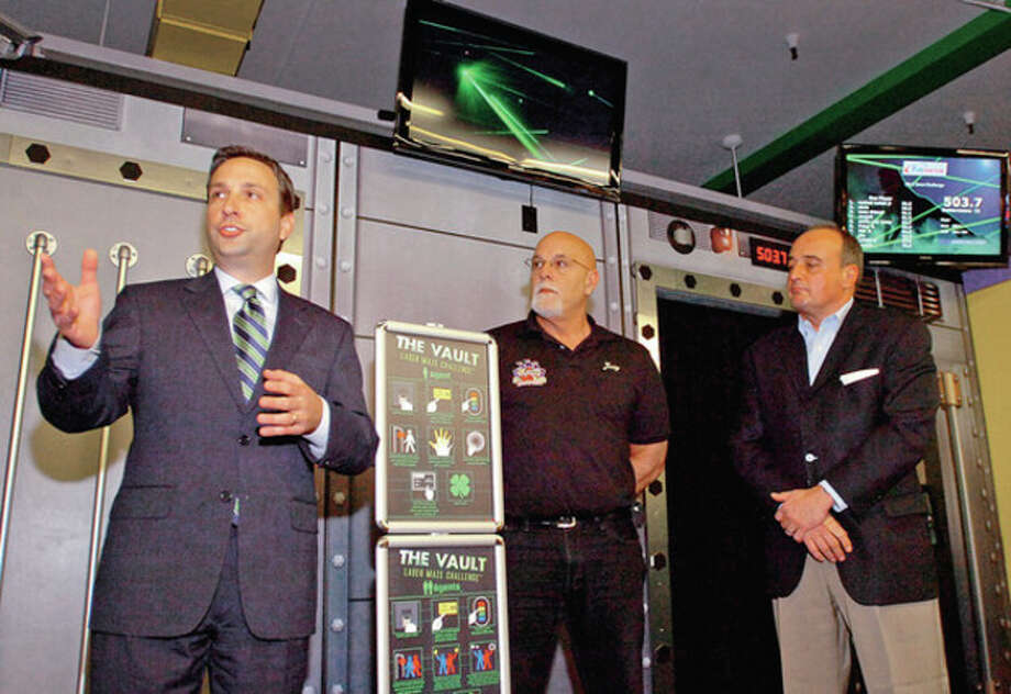 Hour photo / Erik TrautmannState Senator Bob Duff, owner of My Three Sons, Jerry Petrini, and state Rep. Larry Cafero talk during the unveiling of My Three Sons' recent expansion Friday, which includes The Vault: Laser Maze Challenge. / (C)2011, The Hour Newspapers, all rights reserved