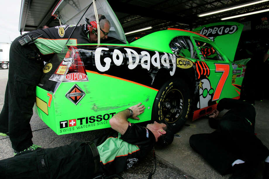 The crew for NASCAR driver Danica Patrick make adjustments to her car during practice for the Nationwide Series auto race, Friday, May 11, 2012 in Darlington, S.C. (AP Photo/Mary Ann Chastain) / FR170217 AP