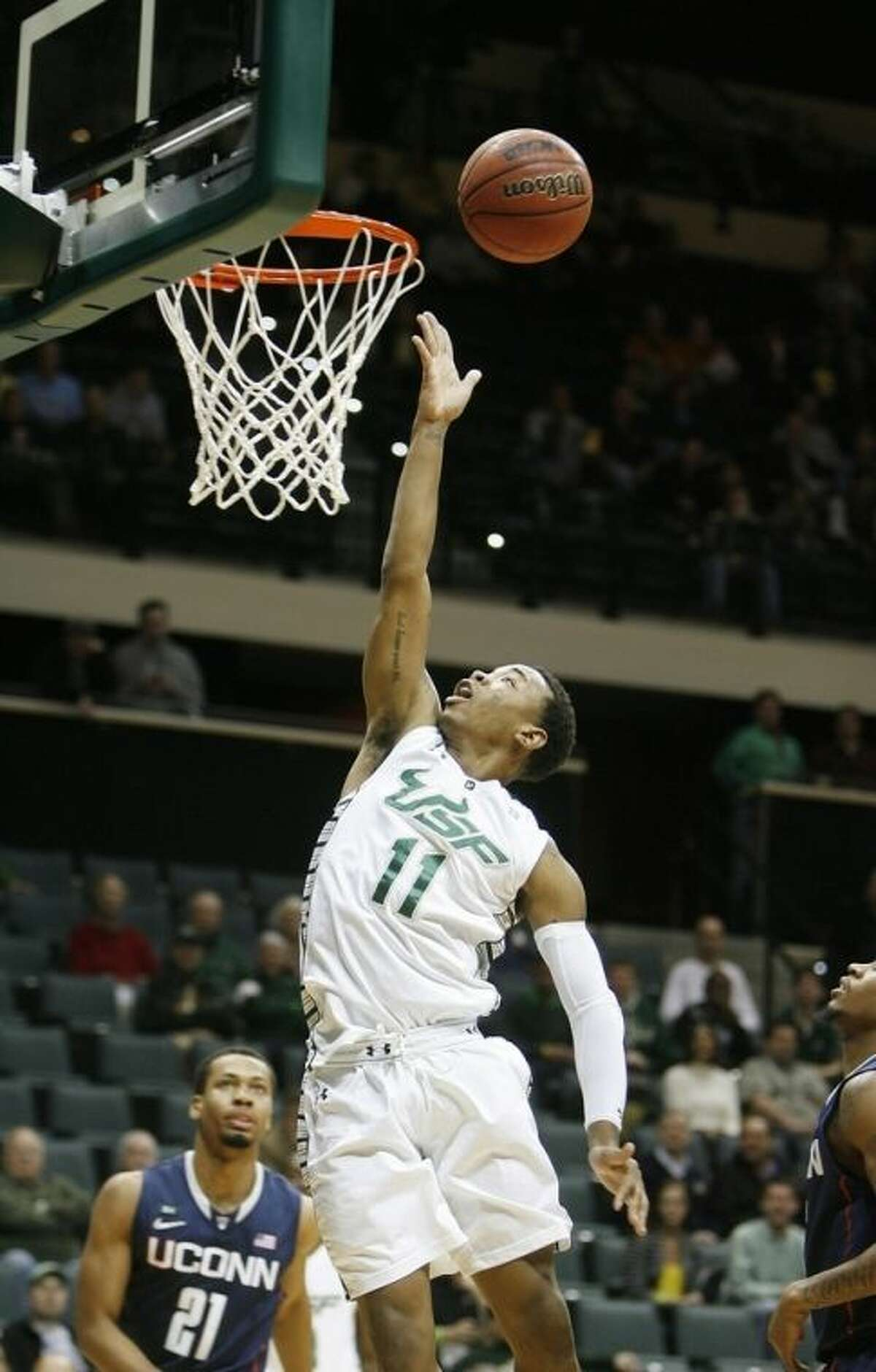 South Florida's Anthony Collins (11) drives the lane against Connecticut during the first half of an NCAA college basketball game Wednesday, March 6, 2013, in Tampa, Fla. (AP Photo/The Tampa Bay Times, Octavio Jones) TAMPA, CITRUS COUNTY, PORT CHARLOTTE, AND BROOKSVILLE HERNANDO TODAY OUT USA TODAY OUT