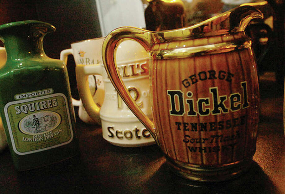 Mike Siano 's water pitcher collection of over 150 pitchers he has collected since 1951. / (C)2011, The Hour Newspapers, all rights reserved