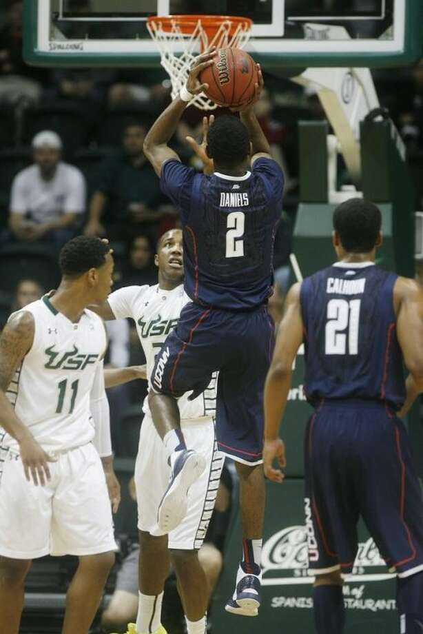 Connecticut's Deandre Daniels shoots over South Florida's Victor Rudd, rear, during the first half of an NCAA college basketball Wednesday, March 6, 2013, in Tampa, Fla. (AP Photo/The Tampa Bay Times, Octavio Jones) TAMPA, CITRUS COUNTY, PORT CHARLOTTE, AND BROOKSVILLE HERNANDO TODAY OUT USA TODAY OUT
