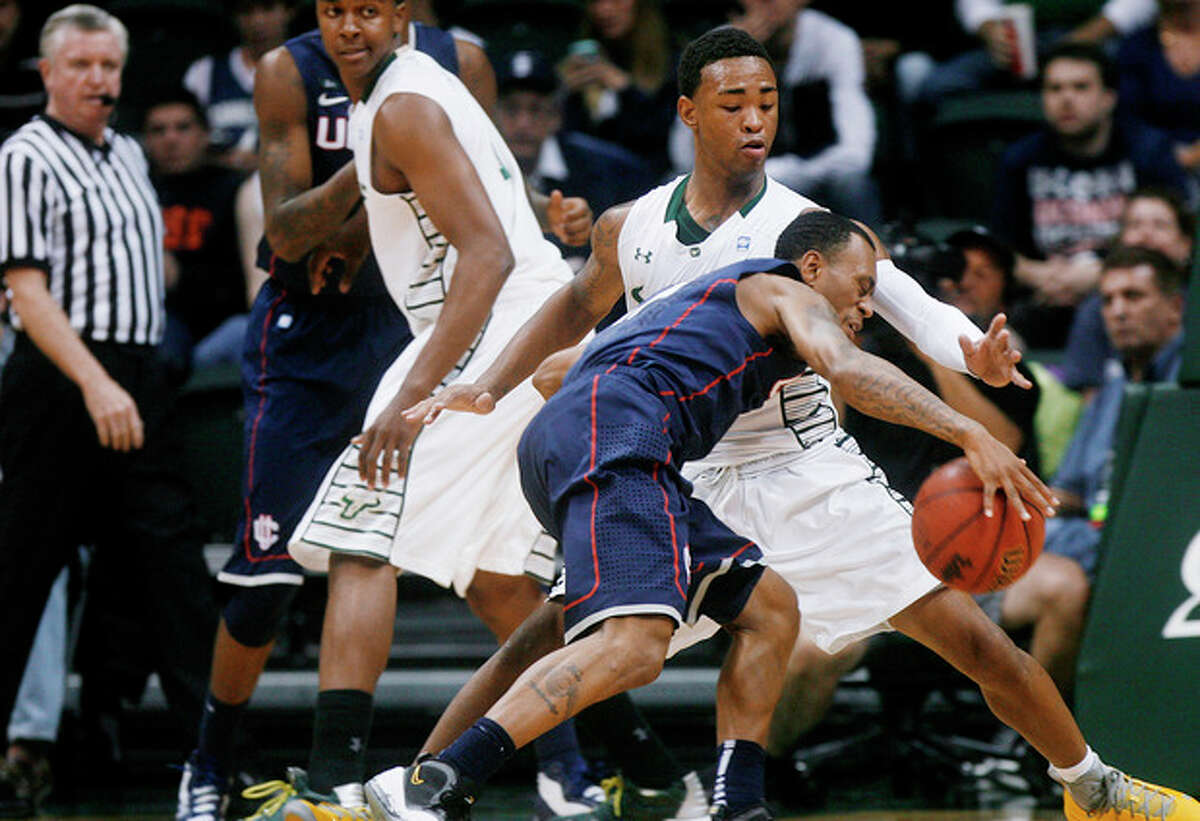 South Florida's Anthony Collins, back right, defends Connecticut's Ryan Boatright during the first half of an NCAA college basketball game Wednesday, March 6, 2013, in Tampa, Fla. (AP Photo/The Tampa Bay Times, Octavio Jones) TAMPA, CITRUS COUNTY, PORT CHARLOTTE, AND BROOKSVILLE HERNANDO TODAY OUT USA TODAY OUT