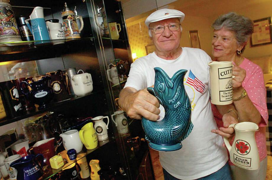 Hour photo / Erik Trautmann Mike and Marie Siano with his water pitcher collection. / (C)2011, The Hour Newspapers, all rights reserved