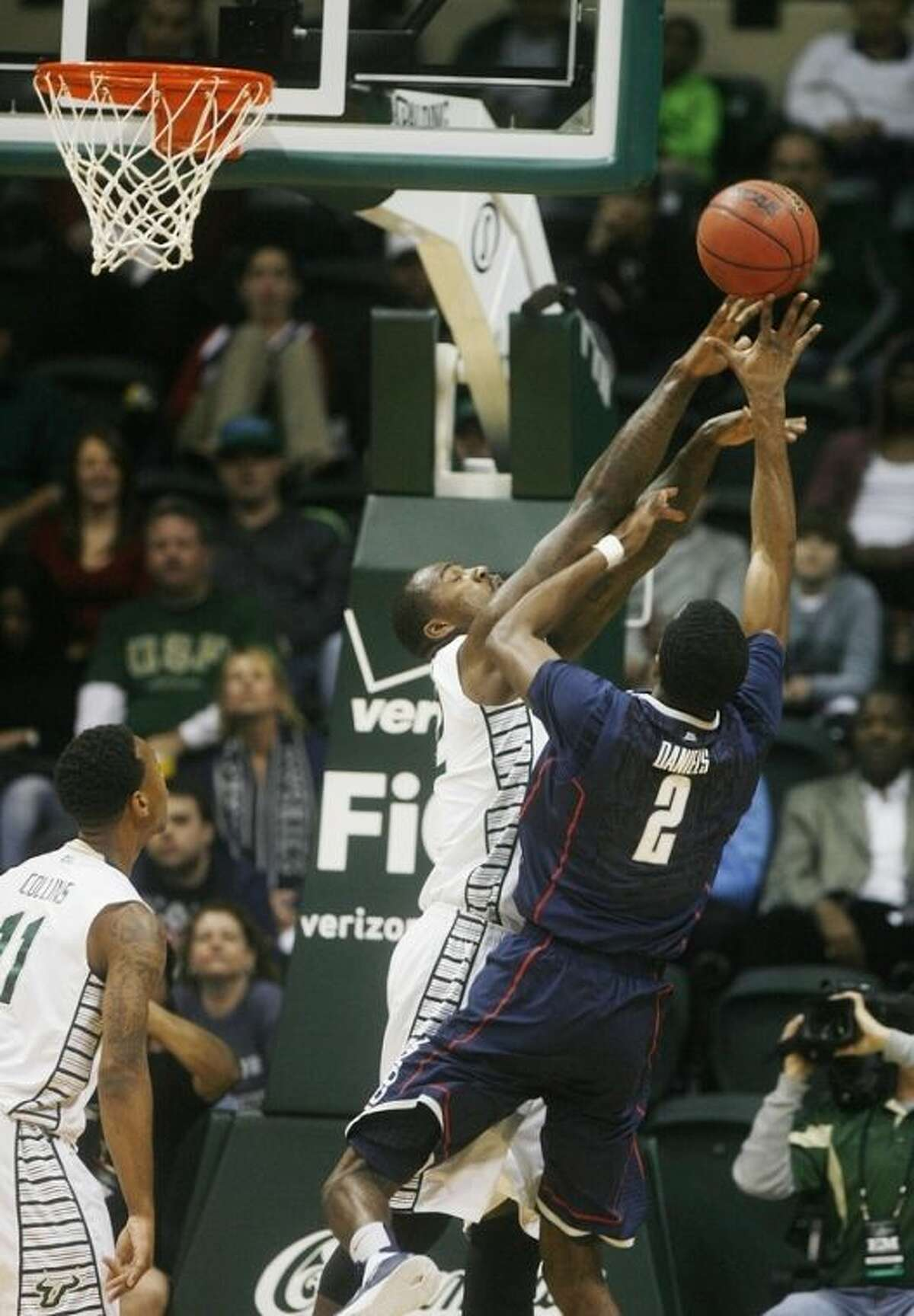 South Florida's Toarlyn Fitzpatrick (32) blocks the shot of Connecticut's Deandre Daniels (2) during the first half of an NCAA college basketball game Wednesday, March 6, 2013, in Tampa, Fla. (AP Photo/The Tampa Bay Times, Octavio Jones) TAMPA, CITRUS COUNTY, PORT CHARLOTTE, AND BROOKSVILLE HERNANDO TODAY OUT USA TODAY OUT