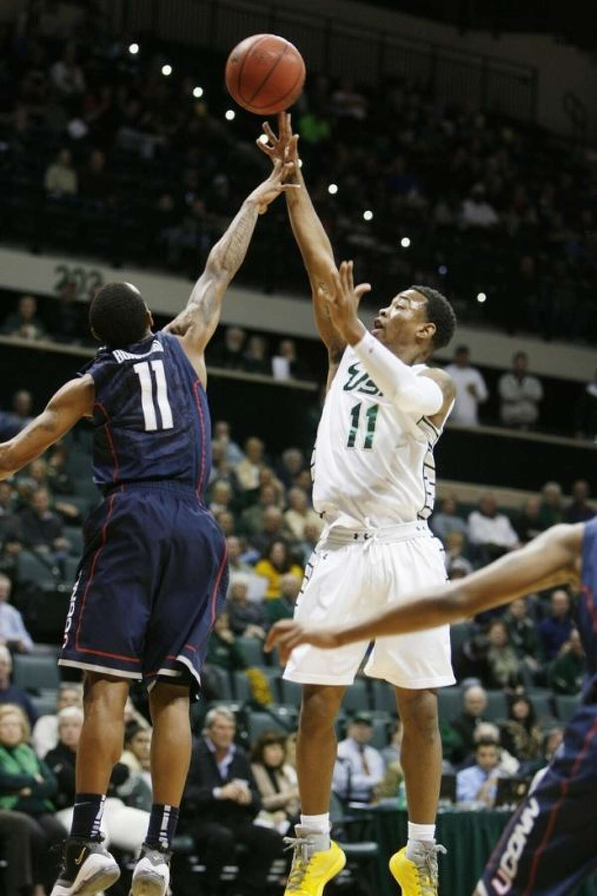 South Florida's Anthony Collins shoots over Connecticut's Ryan Boatright during the first half of an NCAA college basketball game Wednesday, March 6, 2013, in Tampa, Fla. (AP Photo/The Tampa Bay Times, Octavio Jones) TAMPA, CITRUS COUNTY, PORT CHARLOTTE, AND BROOKSVILLE HERNANDO TODAY OUT USA TODAY OUT