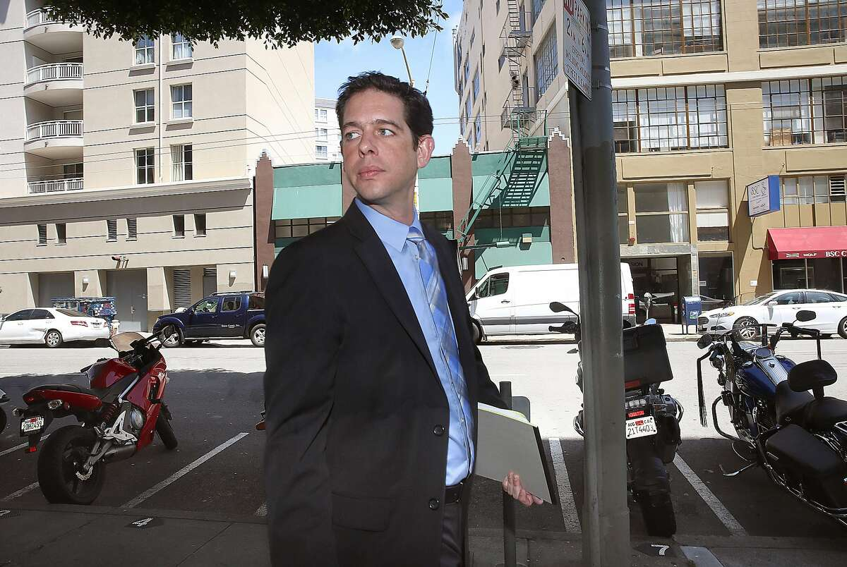 Kevin Guy, head of the office of short term rentals and Planner III at City and County of San Francisco walks next door from his planning office to where hosts register their short term rentals on Monday, June 13, 2016 in San Francisco, Calif..