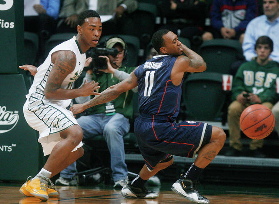 South Florida's Anthony Collins, left, makes the steal against Connecticut's Ryan Boatright during the first half of an NCAA college basketball game Wednesday, March 6, 2013, in Tampa, Fla. (AP Photo/The Tampa Bay Times, Octavio Jones) TAMPA, CITRUS COUNTY, PORT CHARLOTTE, AND BROOKSVILLE HERNANDO TODAY OUT USA TODAY OUT / The Tampa Bay Times