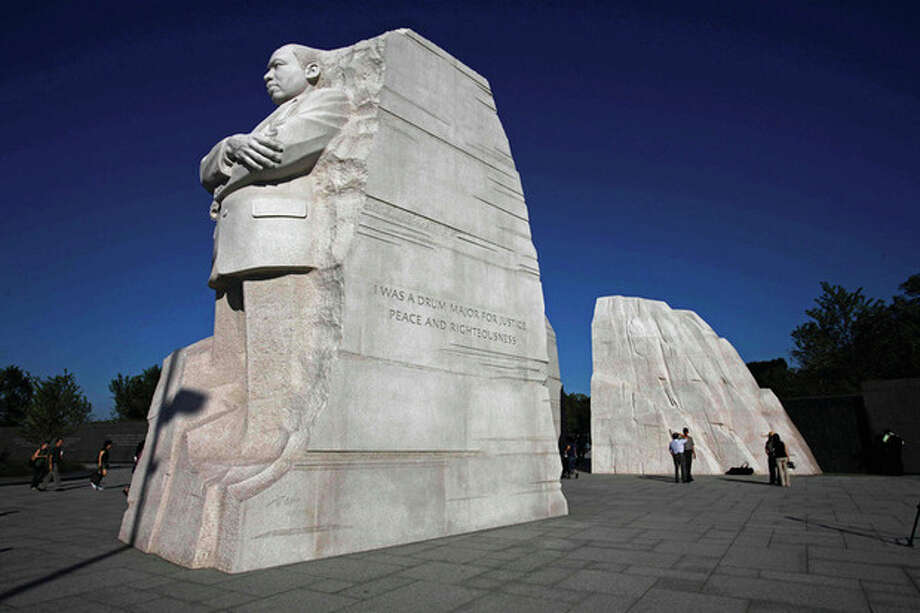 AP photo / Jacquelyn Martin The statue of Dr. Martin Luther King, Jr. is seen unveiled from scaffolding during the soft opening of the Martin Luther King, Jr. Memorial in Washington, Monday. The memorial will be dedicated Sunday. / AP