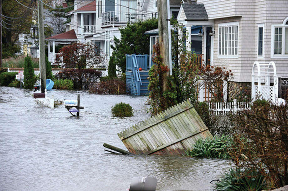Hour photo / Erik TrautmannWestport neighborhoods near the waterfront were inundated with storm surge and high winds bringing down trees and blocking streets. / (C)2012, The Hour Newspapers, all rights reserved