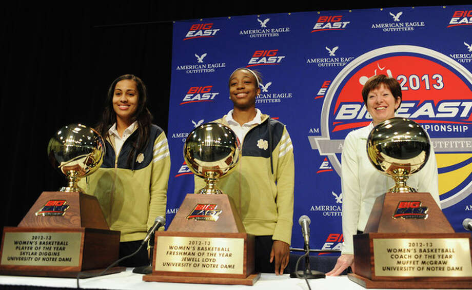 From the left, Notre Dame's Skylar Diggins, poses with the Big East Conference's women's basketball player of the year award. Jewell Loyd with the conference freshman of the year Award, and head coach Muffet McGraw with the conference coach of the year award after a news conference in Hartford, Conn., Friday, March 8, 2013.(AP Photo/Jessica Hill) / FR125654 AP