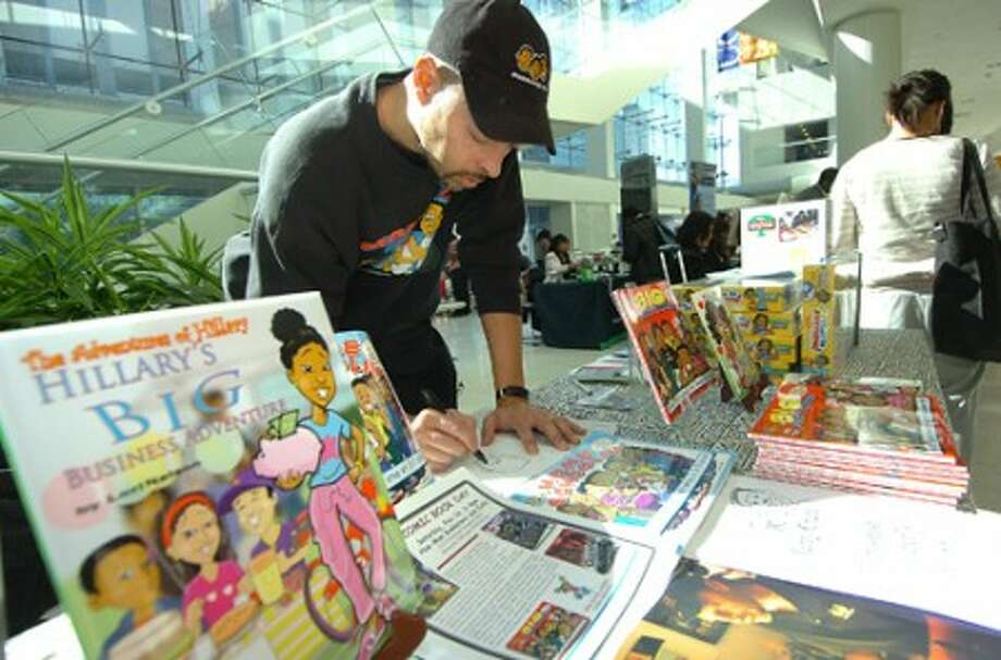 Photo/Alex von Kleydorff. Jerry Craft , Mama''s Boyz Cartoonist and Childrens books author draws one of his characters during UCONN''s community expo celebrating Black History Month.