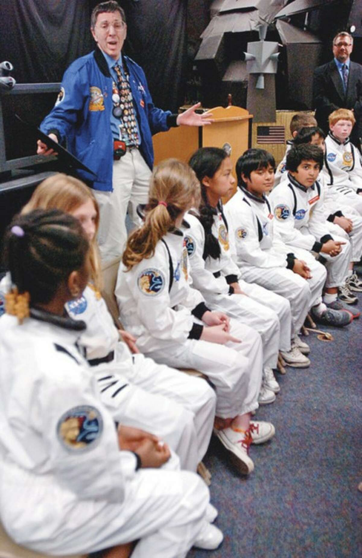 Program Director Andrew Pearce congratulates his crew after completing their simulated mission, XVII Quadragesimal, as part of Columbus Magnet School's Young Astronaut program Friday. Hour photo / Erik Trautmann