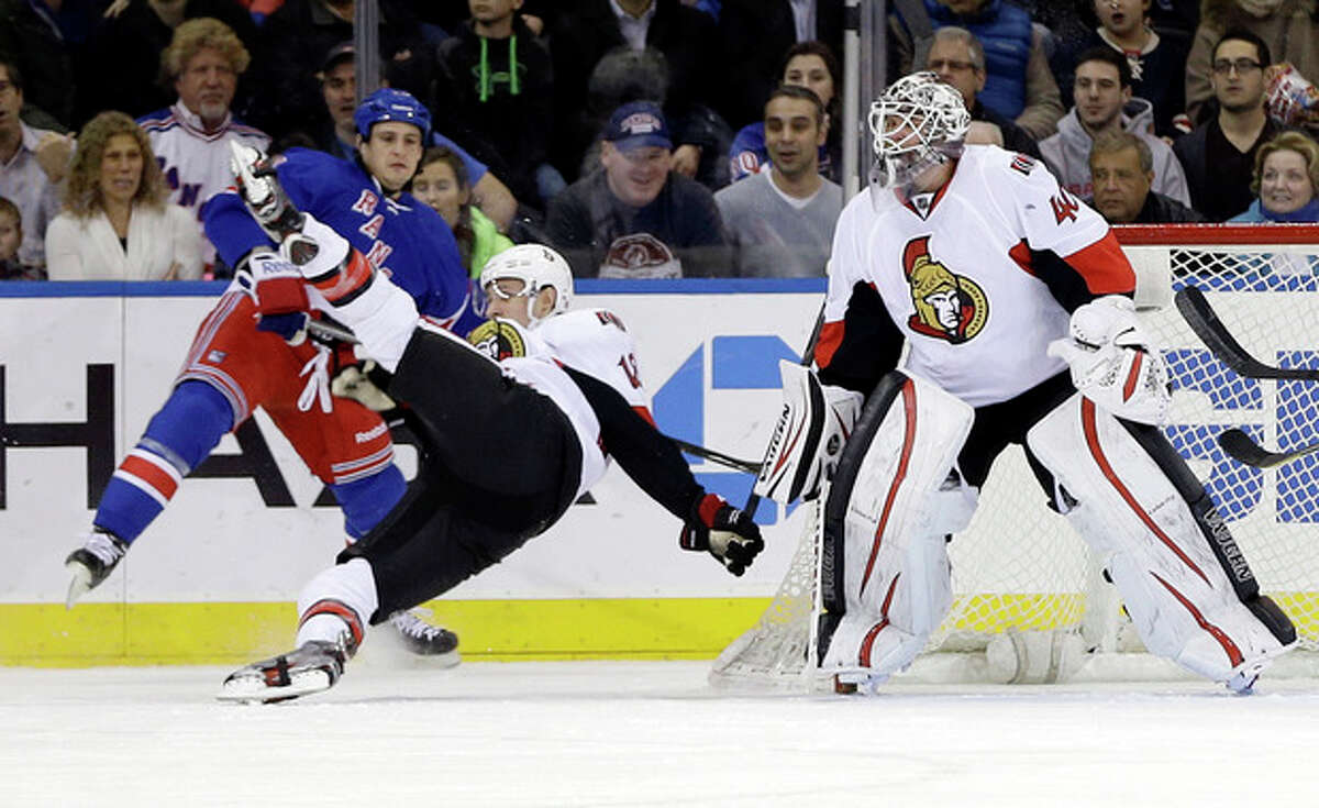 Ottawa Senators goalie Robin Lehner, right, watches his teammate Jim O'Brien, center, falls after being hit by New York Rangers' Micheal Haley during the first period of an NHL hockey game Friday, March 8, 2013, in New York. (AP Photo/Frank Franklin II)