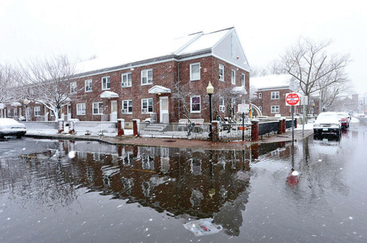@Cutline Byline:Hour photo / Erik Trautmann Snowstorm Saturn which blew back over Norwalk after going out into the Atlantic left 3 inhces of snow on the ground and flooding on water St near Washington Village.