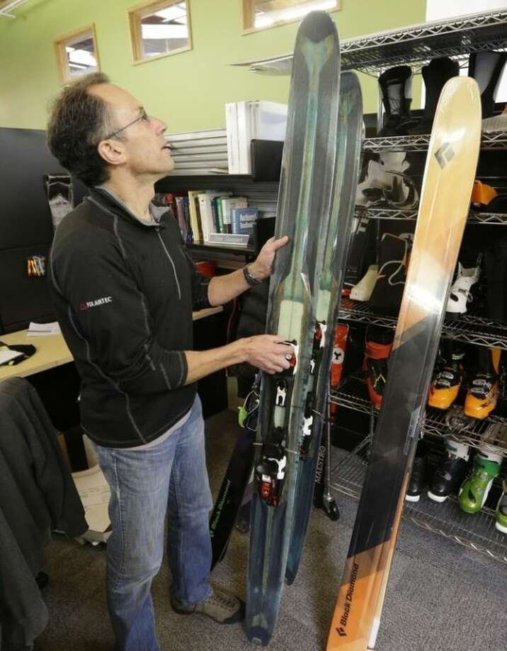 """In this Feb. 22, 2013 photo, Peter Metcalf, president and CEO of Salt Lake City-based Black Diamond Inc., looks at skis during an interview, in Holladay, Utah. The nomination of Sally Jewell, a mountain-climbing CEO, underscores the growing power and influence of outdoor recreation as an economic and political force. """"It's a total game-changer, a recognition of changes in how public lands are used,"""" said Metcalf, a maker of ski and climbing gear and apparel. """"Politics in Washington have finally caught up with reality."""" (AP Photo/Rick Bowmer)"""