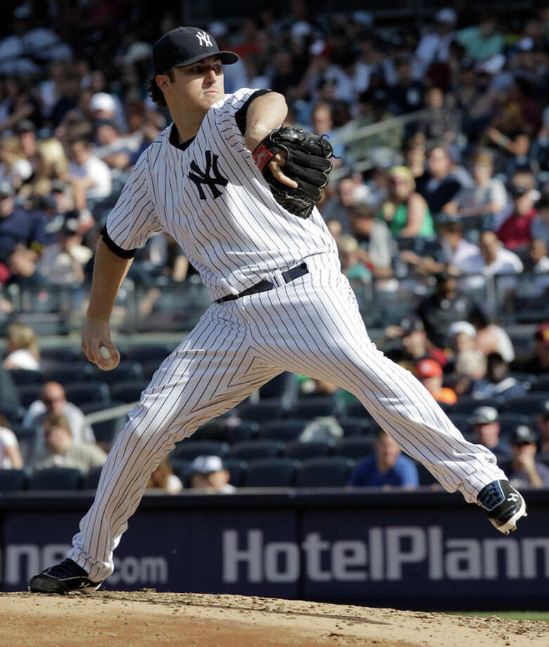 New York Yankees pitcher Phil Hughes throws in the third inning of a baseball game against the Seattle Mariners on Saturday, May 12, 2012 in New York. (AP PhotoPeter Morgan) / AP