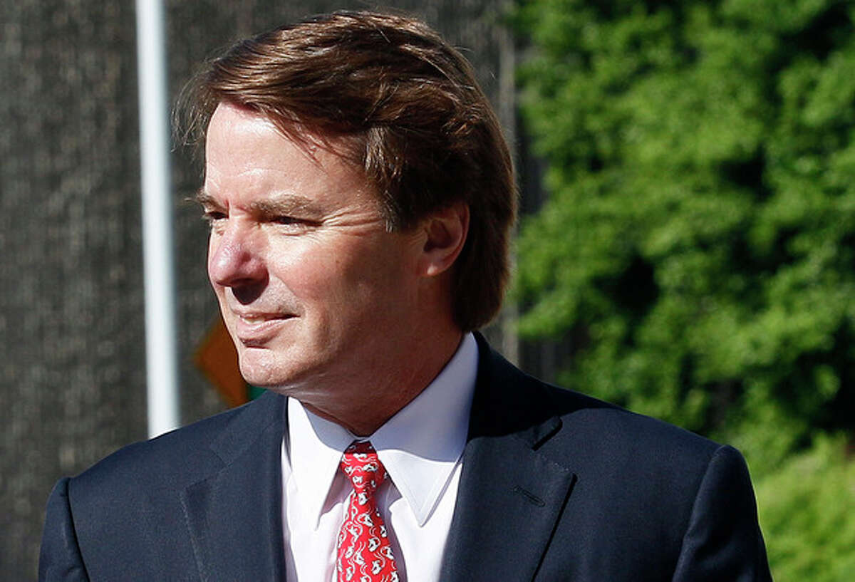 Former presidential candidate and Sen. John Edwards arrives at a federal courthouse in Greensboro, N.C., Thursday, May 10, 2012. Edwards is accused of conspiring to secretly obtain more than $900,000 from two wealthy supporters to hide his extramarital affair with Rielle Hunter and her pregnancy. He has pleaded not guilty to six charges related to violations of campaign-finance laws. (AP Photo/Gerry Broome)