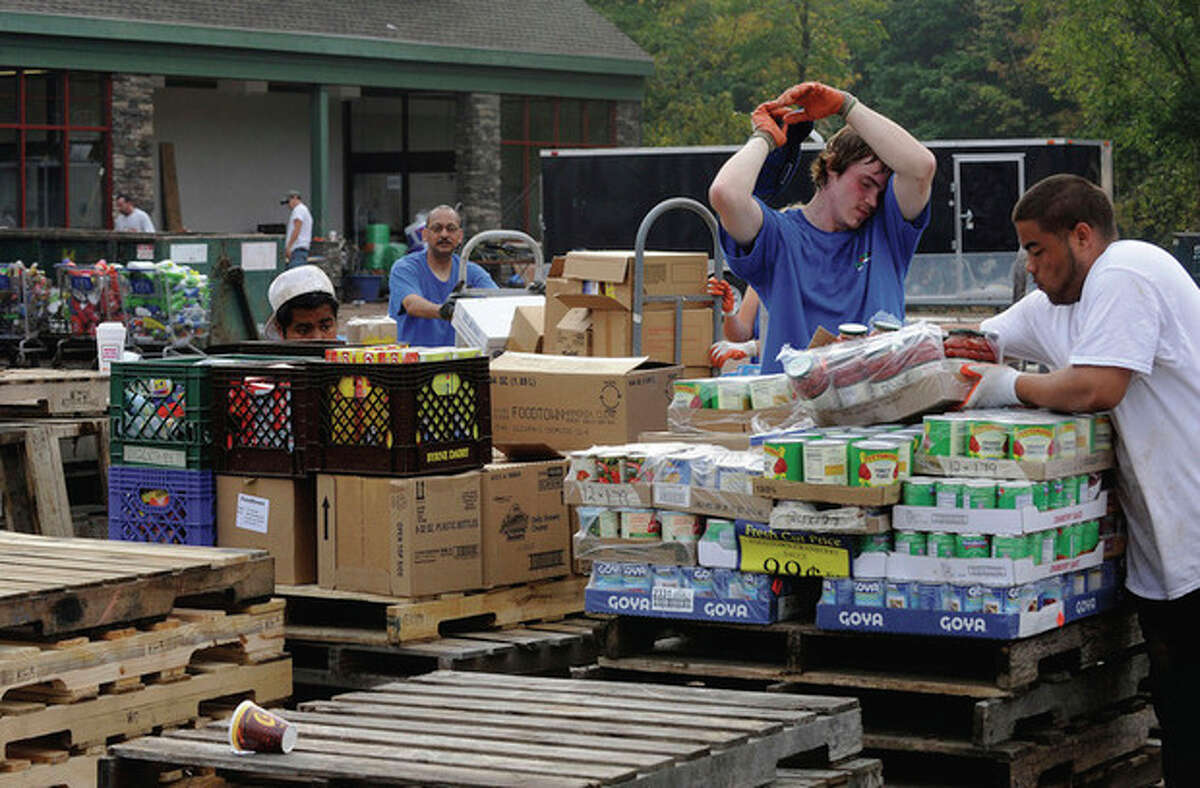AP Photo/Hans Pennink Family-owned Freshtown Marketplace employees clean up Sunday after Tropical Storm Irene flooded store No. 604 in Margaretville, N.Y.