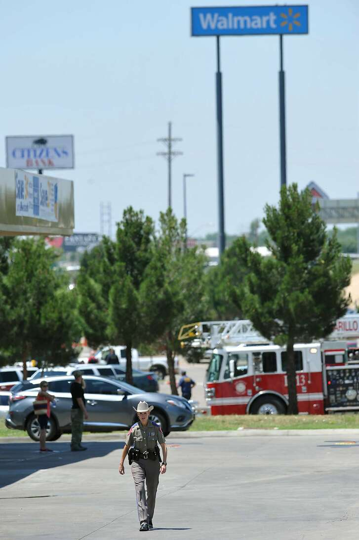 A police officer walks near a Wal-Mart store where officers responded to a reported shooting, Tuesday, June 14, 2016, in Amarillo, Texas. (Michael Schumacher /The Amarillo Globe News via AP) MANDATORY CREDIT